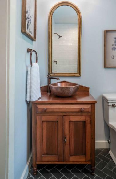 blue-bathroom-gold-mirror-copper-sink